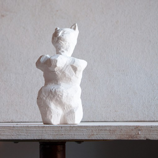 modern figurative sculpture of cat person - plaster