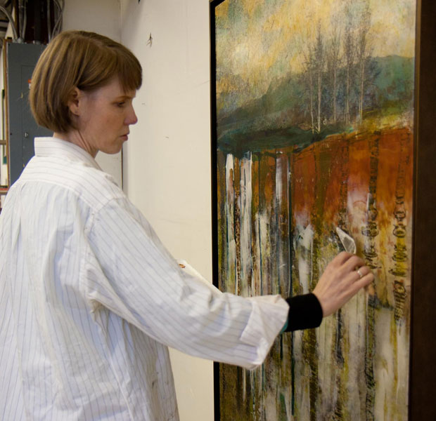 Vancouver artist Ellen Scobie applying acrylic glaze with palette knife to canvas | Ellen Scobie Fine Art Printmaking