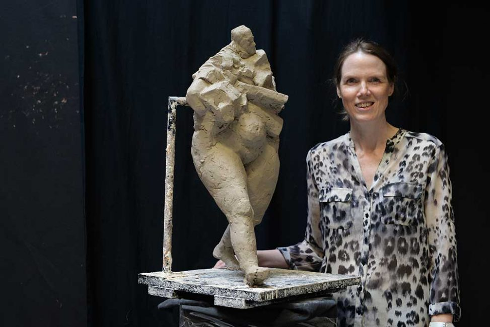 Walking figure, clay maquette by Ellen Scobie