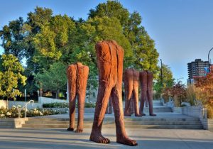 cast iron sculptures of headless or armless torsos with legs by Polish artist Magdalena Abakanowicz
